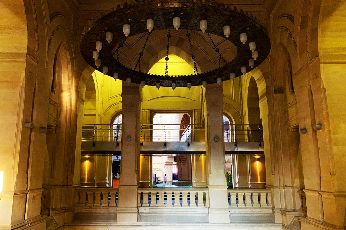 dar el kotob entrance hall historical building chandelier big space stone wall bearing structure
